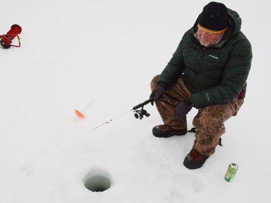 Greg Munger of Missoula jigs for kokanee salmon or bull trout on Salmon Lake on Saturday.