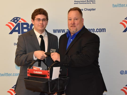 St. Georges' Ryan Hopkins, Electrical Trades '17, receives the ABC Delaware Student Award from Pete Thursby from DiSabatino Construction.