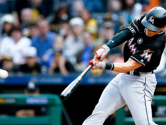 Miami Marlins' Derek Dietrich hits a pitch off Pittsburgh Pirates starting pitcher Gerrit Cole for a double to drive in two runs in the first inning of a baseball game, Thursday, June 8, 2017, in Pittsburgh. (AP Photo/Keith Srakocic)
