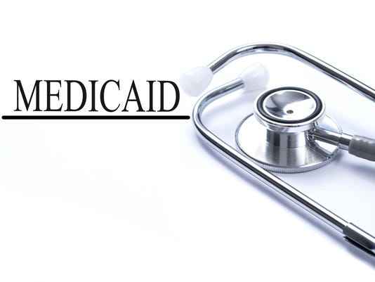 Page with medicaid on the table with stethoscope, medical concept