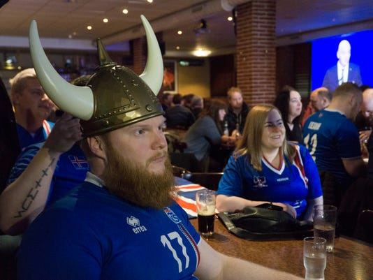 Iceland soccer fans watch the 2018 World Cup draw from a sports bar in Reykjavik, Sunday, Nov. 26, 2017.Iceland is the smallest nation ever to qualify for the World Cup with the finals next year in Russia, being drawn in the tricky Group D with Argentina, Croatia and Nigeria. (AP Photo/David Keyton)
