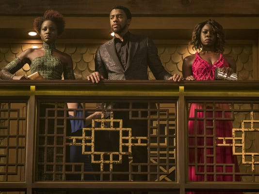 "Lupita Nyong'o, from left, Chadwick Boseman and Danai Gurira appear in a scene from ""Black Panther."""