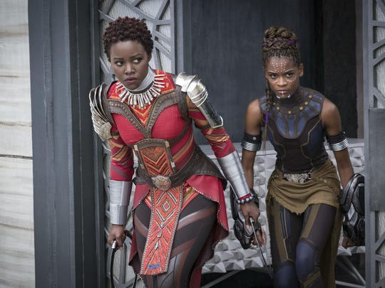 "Lupita Nyong'o, left, and Letitia Wright appear in a scene from ""Black Panther."""