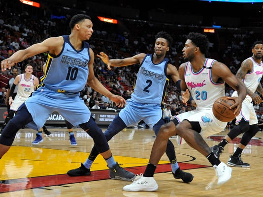 Miami Heat forward Justise Winslow (20) attempts to get past Memphis Grizzlies forward Ivan Rabb (10) and guard Kobi Simmons during the second half of an NBA basketball game in Miami on Saturday, Feb. 24, 2018. The Heat won 115-89. (AP Photo/Gaston De Cardenas)