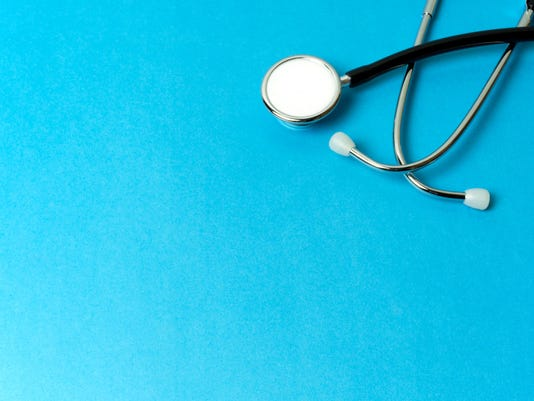 Stethoscope on Blue Background with Copy Space
