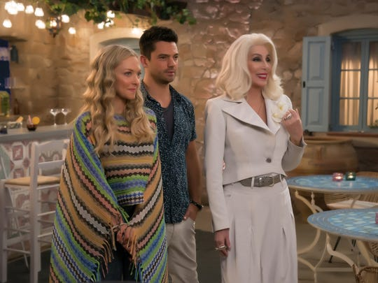 "Sophie (Amanda Seyfried) and Sky (Dominic Cooper) with Ruby (Cher) in ""Mamma Mia! Here We Go Again."" Ten years after ""Mamma Mia! The Movie,"" you are invited to return to the magical Greek island of Kalokairi in an all-new original musical based on the songs of ABBA."