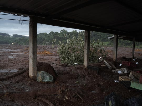 Mud covers what remains of a market after a dam collapse near Brumadinho, Brazil, Saturday, Jan. 26, 2019.