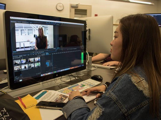 A student in NKU's Journalism & Digital Media Academy editing videos.