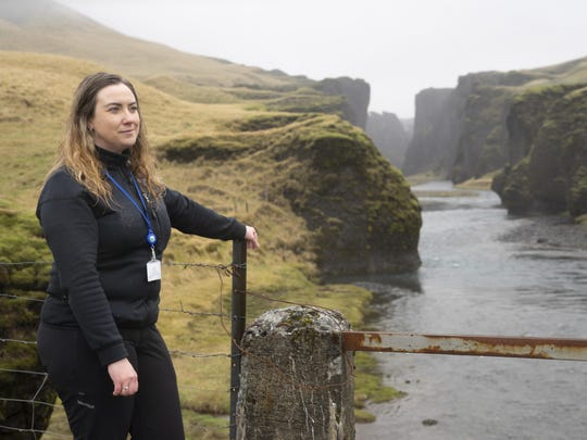 "In this photo taken Wednesday, May 1, 2019, Hanna Johannsdottir, a ranger from The Environment Agency of Iceland, poses for a photograph at the mouth of the Fjadrargljufur canyon. The canyon area has suffered environmental damages after intense traffic, prompted by the music video ""I'll Show You"" by Justin Bieber."