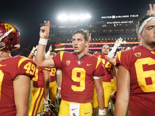 "Aug 31, 2019; Los Angeles, CA, USA; Southern California Trojans quarterback Kedon Slovis (9) gestures with a ""Fight On"" sign after the game against the Fresno State Bulldogs at Los Angeles Memorial Coliseum. USC defeated Fresno State 31-23.  Mandatory Credit: Kirby Lee-USA TODAY Sports"