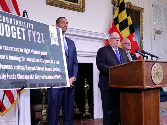 Maryland Gov. Larry Hogan outlines his budget proposal for the next fiscal year during a news conference Tuesday in Annapolis.