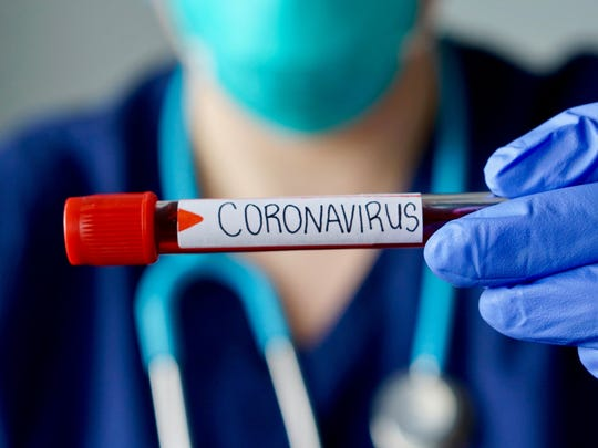 A blood test with coronavirus label.