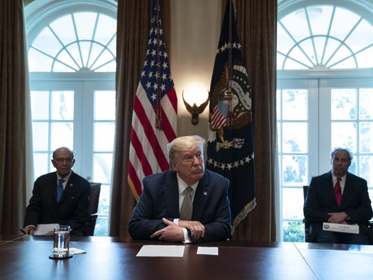President Donald Trump listens during a meeting with tourism industry executives about the coronavirus, in the Cabinet Room of the White House, Tuesday, March 17, 2020, in Washington. (AP Photo/Evan Vucci)