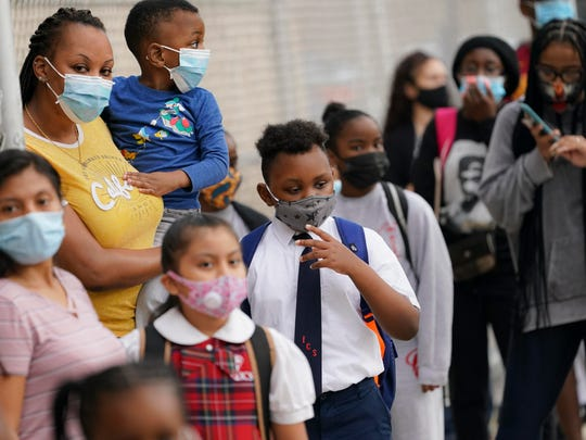 Students wear protective masks as they arrive for classes at the Immaculate Conception School while observing COVID-19 prevention protocols in The Bronx borough of New York on Sept. 9.