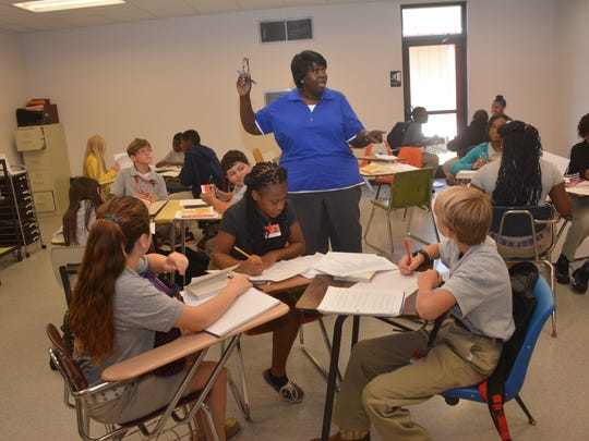 Phyllis Morris (blue shirt, center) teaches her seventh-grade ELA class in the new building built at Bunkie New Tech High School on Friday. The new building is part of a district-wide plan to upgrade facilities.