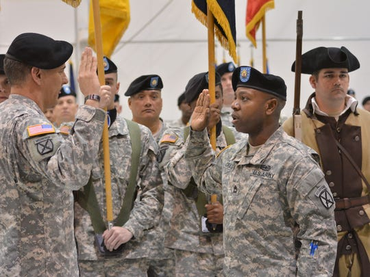 Maj. Gen. Stephen J. Townsend (left), the 10th Mountain Division commander, conducts the reenlistment of Sgt. 1st Class Eleazar L. Craig (right) at Fort Polk Tuesday, Feb. 24, 2015 during which the 4th Brigade, 10th Mountain Division, was reflagged as the 3rd Brigade, 10th Mountain Division.