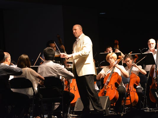 """ANI Pops on the River Rapides Symphony Orchestra music director and conductor Joshua Zona (center, standing) leads the RSO through """"A High Voltage Night of Music"""" Saturday, Sept. 27, 2014 at the Alexandria Riverfront Center in downtown Alexandria.-Melinda"""