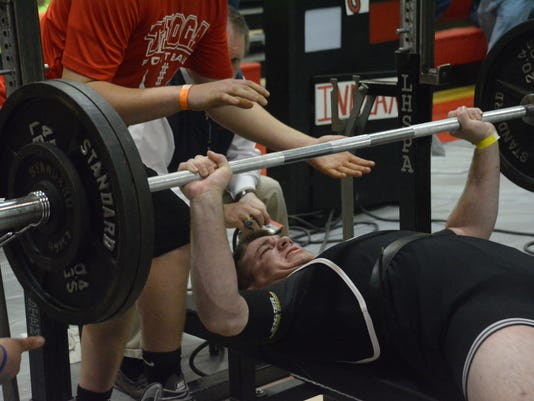 ANI Tioga Powerlifting Tioga High School senior Brenden Malone bench presses 245 pounds at the LHSAA division II powerlifting meet held Friday, March 20, 2015 at Tioga High School.-Melinda Martinez/mmartinez@thetowntalk.com
