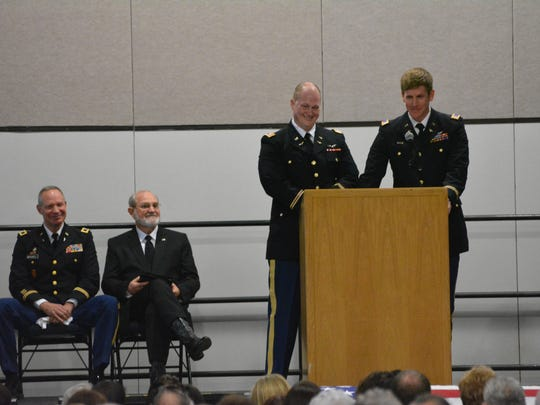 Capt. Mike Permenter (second from right) and Chief Warrant Officer 2 Jesse Futrell (far right) share memories of the late David Strother during a funeral service in the Alexandria Riverfront Center. Seated are chaplain Col. Jeffrey Mitchell (left) and the Rev. Darryl Hoychick of Trinity Baptist Church.