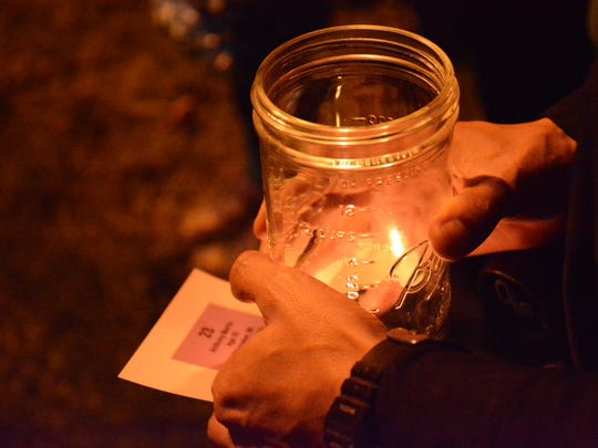 One of 40 candles lit on Oct. 14 outside the Algoma Youth Center to remember the victims of domestic violence homicide in 2013 in Wisconsin.