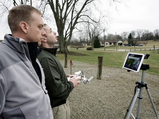 Ryan Anschutz and John Bartolucci fly one of their drones Friday during a demonstration for their new company HYSight Technologies in Marshall Park.