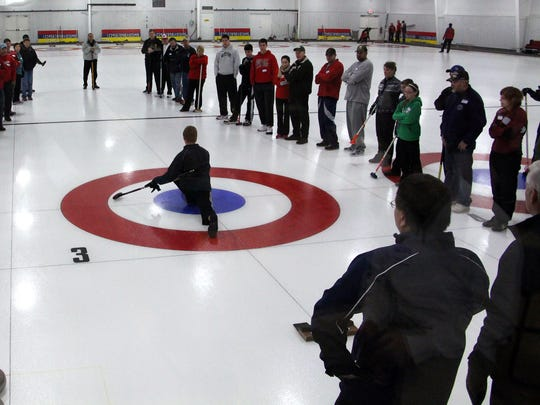People get a demonstration as the Wausau Curling Club
