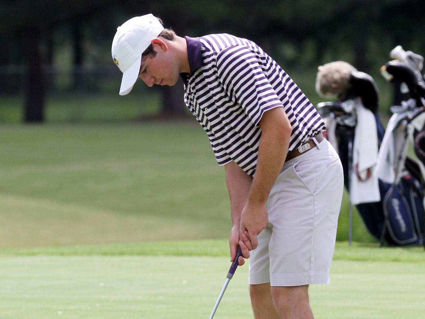 Byrd's Phillip Barbaree putts on the first hole in the 2015 Allstate Sugar Bowl State golf tournament on Monday.