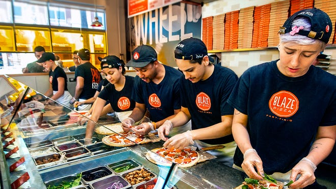 The new Blaze Fast-Fire'd Pizza restaurant near downtown Des Moines will be giving away free pizzas Friday to customers showing they follow the company on social media.