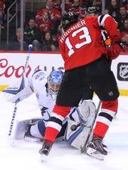 Tampa Bay goaltender Andrei Vasilevskiy stops Nico