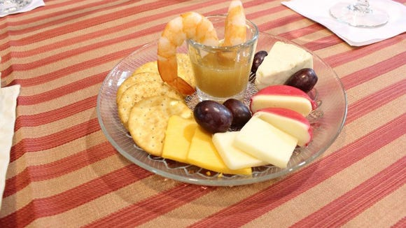 The signature tasting at Green Creek Winery includes crackers, cheese, fruit, wine-infused cake, wine fudge and shrimp with a special lemon chardonnay sauce.