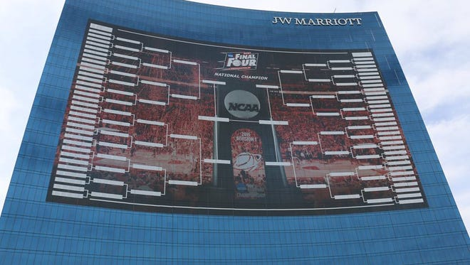 The NCAA finished up its 165-foot-tall bracket Thursday on the side of the J.W. Marriott Downtown.