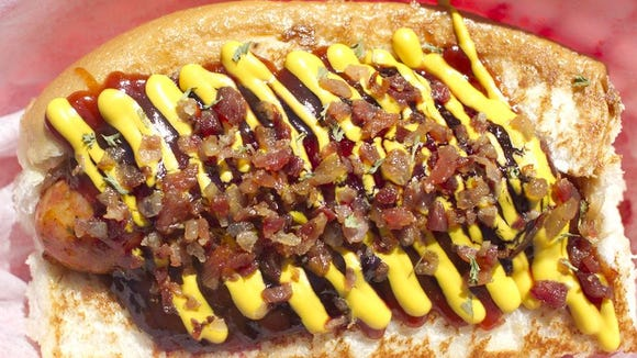 Dat Dog offers interesting takes on wieners, such as this duck special, made from duck sausage, blackberry preserves, homemade barbecue sauce, bacon and mustard. Dat Dog is considering opening a Lafayette location.