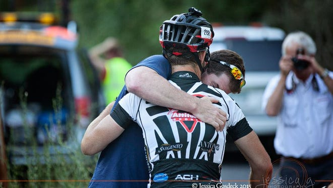Dave Haase embraces his brother, Dean, at one of the final time stations of the Race Across America ultra-cycling contest in Cumberland, Maryland.