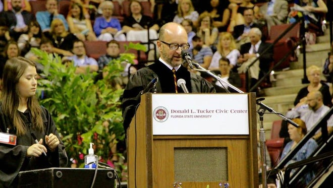 FSU communications professor Mark Zeigler serves as head marshall for graduation.