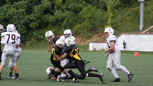 The Asheville Saints' JV football team won Saturday