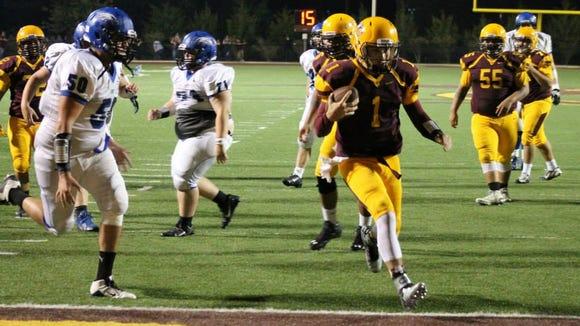 Cherokee quarterback Tye Mintz scores a touchdown in Friday's home win over Cosby (Tenn.).