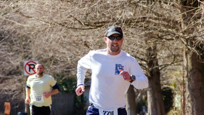 Rob Schultheis running in the 2015 St. Paddy's Day 5K in Salisbury.