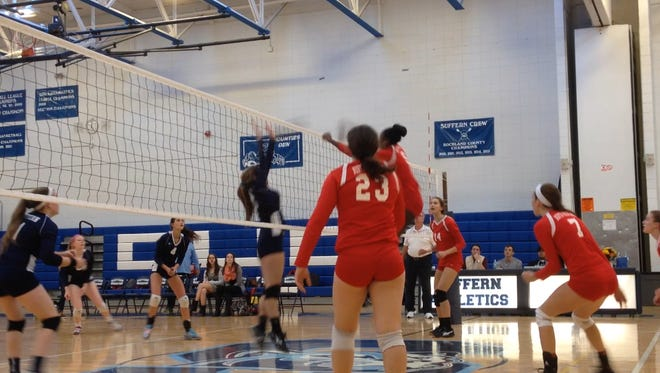 North Rockland freshman Jaida Patrick puts down an over pass during a Section 1 Class AA first-round match against Suffern. Oct. 30, 2015.