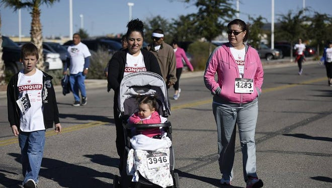 Hundreds of runners took part in the Rochelle Nieman Memorial Run Conquer Race Against Ovarian Cancer, including Sephra Beck, who pushed her daughter Adelina in a stroller, her son Jared Beck and her friend Lorraine Herrera. The run/walk took place Nov. 7 at Abundant Living Faith Center.