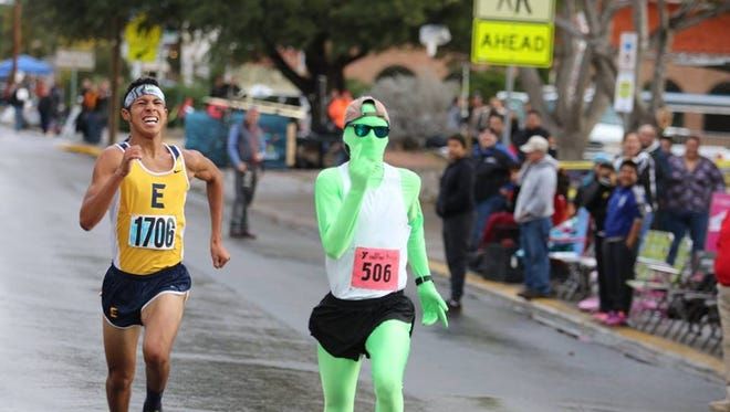 Hundreds of runners braved the rain during the YMCA of El Paso's annual Turkey Trot on Thanksgiving morning. Luis Romero (in all green), a senior at Texas A&M University-Commerce outkicked Eastwood High School senior Matt Muñoz in the final seconds to win the 5K race.