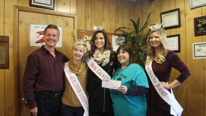 Franklin Bank generously donated $500 to Project Thanksgiving to benefit the Food Bank of South Jersey. Kim Cruz, vice president at Franklin Bank corporate office in Woodstown, presents the check to Alex Kaganzev, co-founder Project Thanksgiving. (From left)  Alex Kaganzev, co-founder Project Thanksgiving, Miss Gloucester County's Outstanding Teen Shellby Watts, Miss Gloucester County Emily Williamson, Kim Cruz, vice president, Franklin Bank and Miss South Jersey Julia Magill, are pictured at the check presentation.