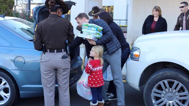 Emma Short, 4, delivers gifts to patients at Nemours/Alfred I. duPont Hospital for Children Monday.