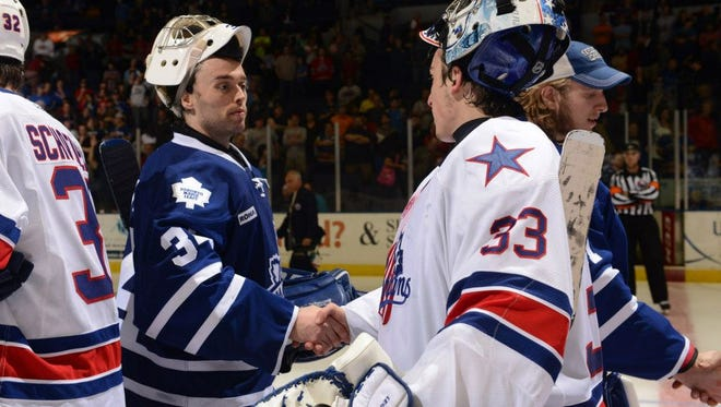 The Rochester Americans and Toronto Marlies shake hands at the conclusion of a playoff series on May 1, 2013.