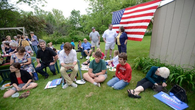 People wait for Bernie Sanders to arrive at a house party in West Branch, Iowa, on Friday night, May 29, 2015.