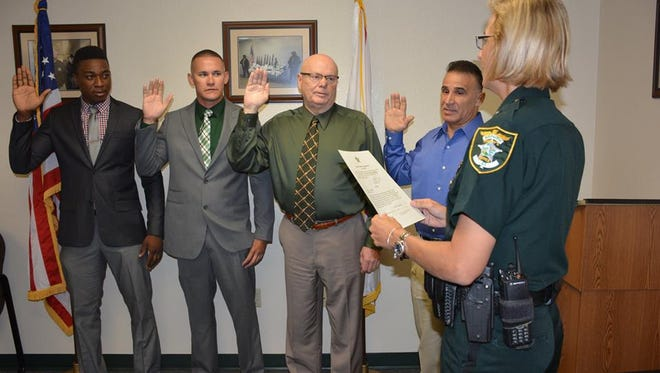 New hires sworn in Wednesday by Lee County Sheriff's Office Major Kathy Rairden:  Renet Louis, Trevor Lehman, John Millican and Sergio Perez.