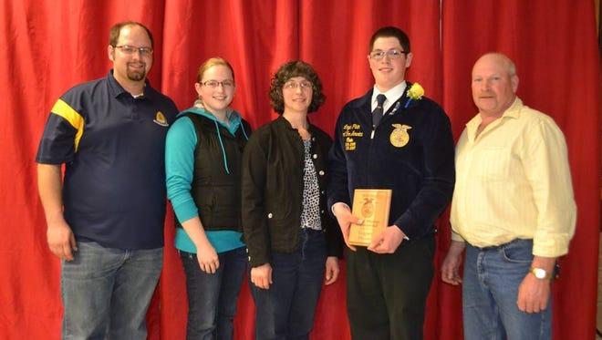 Earning the Bryant Pluim Memorial Award was Logan Pluim.  Pictured from left are Adam Messer, Amanda Messer, Delaine Pluim, Logan Pluim and Steven Pluim