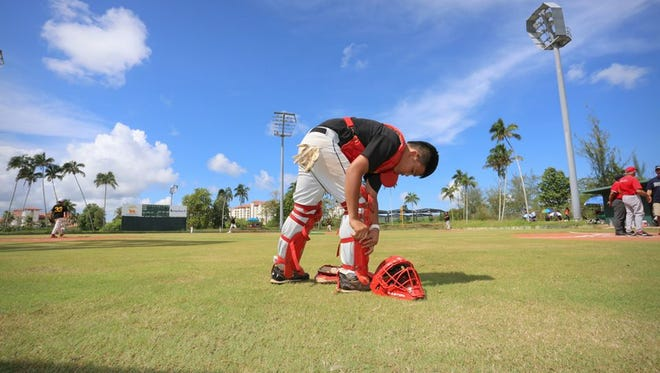 In this file photo, a player gets ready for a youth league game. Guam PONY Baseball kicks off games on Saturday.