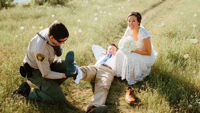 A Fort Collins groom received an unwelcome wedding gift from a rattlesnake while taking photos at Horsetooth Reservoir on Monday evening.