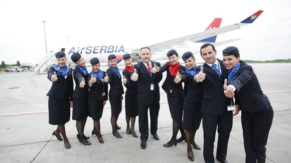 Air Serbia cabin crew members pose with the airline's