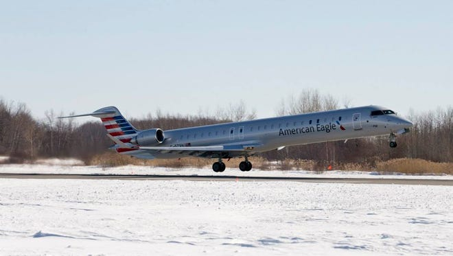 A Bombardier CRJ 900 flying under the American Eagle brand.